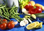 Still life with fresh vegetables, mushrooms & lemons