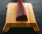 Raw tuna fillet on a sushi board