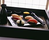 Nigiri sushi on black tray