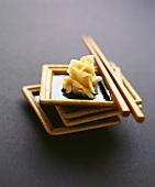 Bottled ginger in bowl with chopsticks
