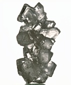 Black and white salt crystal against white background