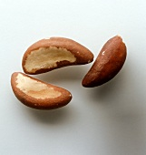 Three shelled Brazil nuts