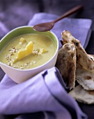Indian curry soup with pineapple; Flat bread