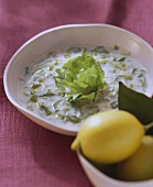 Endive soup with pecorino and basil oil; lemons