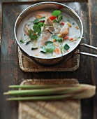 Chicken soup with coconut milk and coriander leaves