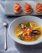 Seafood soup with orange segments