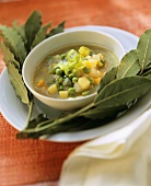 Spring vegetable stew surrounded by bay leaves