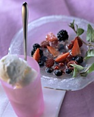Ice-cold berry soup with mint and yoghurt ice cream