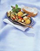 Oven-baked vegetables with fresh herbs & baguette slices