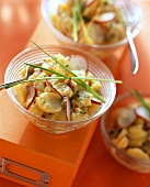 Potato salad with radishes and chives for office party