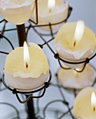 Egg candles: tea lights in halved egg shells
