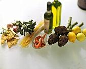 Still life with olive oil, vegetables, shrimps, lemons, noodles