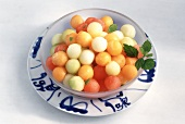 Mixed melon balls in a bowl on plate