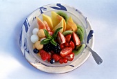 Fruit salad with mint leaf on plate