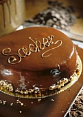 Sacher torte with the word Sacher on a tray