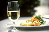 White asparagus with langoustes and cress; White wine glass