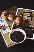 Asian tea still life with tea plait, tea leaves etc