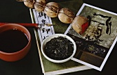 Asian tea scene with tea bowl, tea pearls, tea leaves etc.