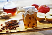 Apple and ginger preserve with Calvados raisins in jar