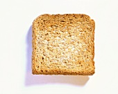A slice of wholemeal toast on white background