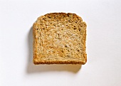 A slice of sunflower bread toast on white background