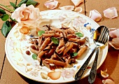 Sweet penne with chocolate sauce, raisins and mint