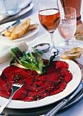 Beef carpaccio with various peppercorns; rose wine