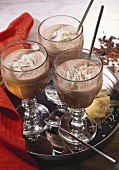 Chocolate shakes with white chocolate curls in glasses