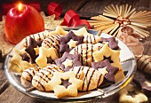 Semolina macaroons and star biscuits on plate; Apple candle