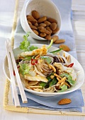 Rice noodles & monkfish, vegetables, almonds & coriander leaves