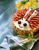 Strawberry marzipan cake, decorated as beetle, on plate