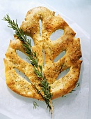 Flat bread in leaf shape with sprig of rosemary