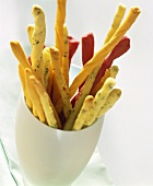 Various party grissini (bread sticks) in beaker