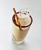 Coffee cocktail (coffee liqueur, whiskey, cinnamon, ice cubes)