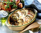Moussaka in a baking dish; olive oil, tomatoes, garlic