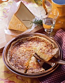 Swiss cheese tart in baking dish; cheese; wine