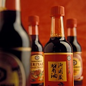 Various Asian spicy sauces in bottles