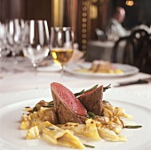 Saddle of venison with chestnut noodles & glazed pearl onions