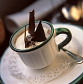 Cappuccino with chocolate flakes and mocha powder