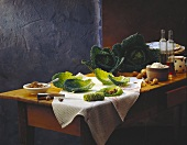 Still life with savoy, mince, nuts etc on table