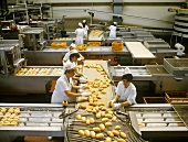 Baguette rolls on the packing line in a bread factory