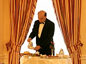 Waiter serving breakfast