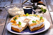 Peach and pepper gateau with cream and peppermint leaves