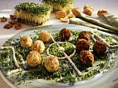 Cheese balls on cress, decorated as football field
