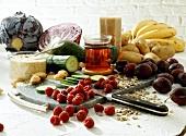 Still life with vegetables, sesame, raspberries, plums, tea