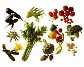 Various fresh vegetables, arranged in groups