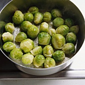 Tossing Brussels sprouts in butter