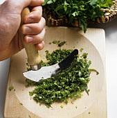 Chopping parsley with a mezzaluna