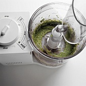 Pureeing herbs in a mixer