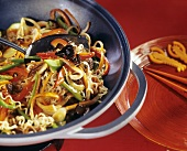 Egg noodles with mixed vegetables in wok
